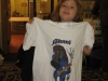 An excitable young lady proudly displays her Ms Johnni T-Shirt.